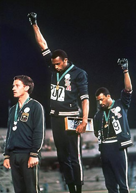 """fair use: """"1968 Olympics Black Power salute"""" by AP photographer - http://i.infoplease.com/images/blackpower.jpg. Licensed under Fair use of copyrighted material in the context of 1968 Olympics Black Power salute via Wikipedia - http://en.wikipedia.org/wiki/File:1968_Olympics_Black_Power_salute.jpg#mediaviewer/File:1968_Olympics_Black_Power_salute.jpg"""